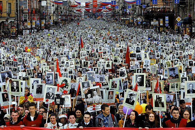 MAY 9: Local residents carry portraits of their relatives, participants in World War Two, as they celebrate Victory Day in St. Petersburg, Russia. About 30,000 people walked in the march called 'Immortal regiment.' Victory Day, marking the defeat of Nazi Germany, is Russia's most important secular holiday. (Dmitry Lovetsky/Associated Press)