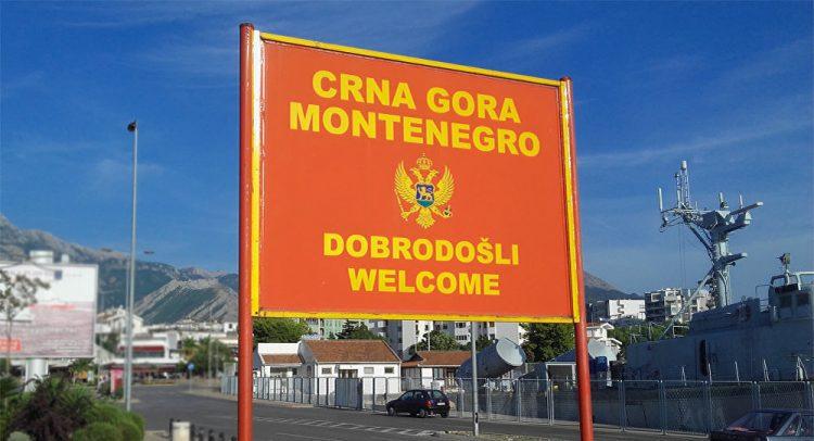 """HODOČASNICIMA IZ HERCEGOVINE ZABRANJENO DA NOSE SRPSKI BARJAK: Crnogorski policajac zaprijetio da će im pokazati """"njihovog Boga"""""""